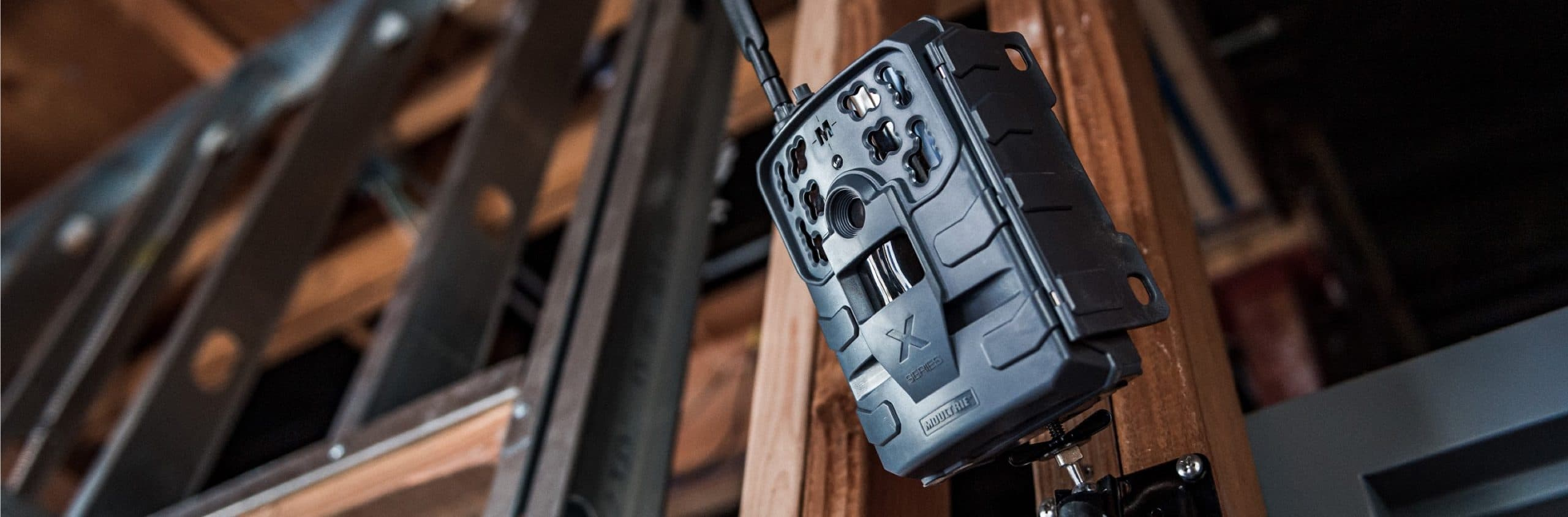Moultrie Cellular Trail Camera posted on beam for security