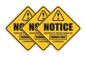 Yellow notice signs for Moultrie camera monitoring for properties