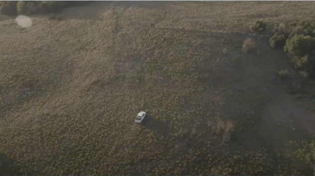 White truck driving through field